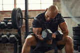 Strong man lifting weight at gym