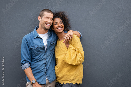 Multiethnic couple in love standing and holding hands