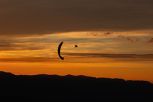 Sunset And Paraglider