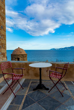 Greek Cafe Or Tavern With Small Table On Outside Terrace With Nice View