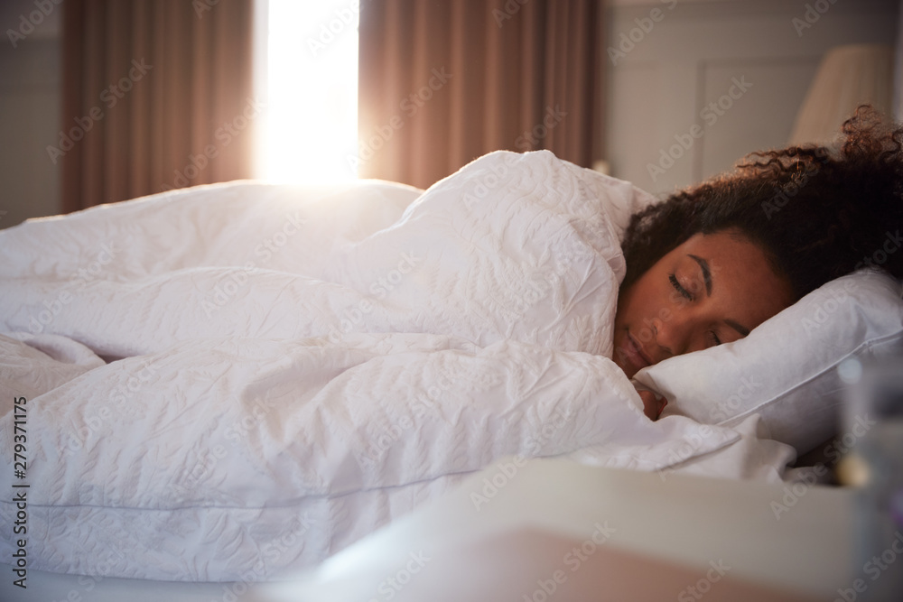 Fototapety, obrazy: Peaceful Woman Asleep In Bed As Day Break Through Curtains