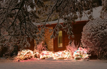 Christmas And New Year Outdoor Decoration Background.Covered By Fresh Snow Front Yard Of Private House Decorated For Winter Holidays.Night Scene With Glowing In The Dark Bushes, Wrapped By Garlands.