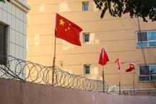 Chinese Flags On Barbed Wired Wall In Kashgar (Kashi), Xinjiang, China.
