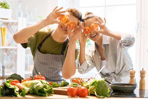 loving couple is preparing the proper meal Canvas