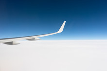 Airplane Wing Above The Cloud Line