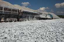 Railway Dump-car After Unloading Gravel In Quarry For Limestone Mining.  Mining Industry. Quarry And Mining Equipment.
