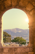 Beautiful Sun Light Through A Medieval Stone Window. Romantic Scenery From The Balcony.