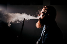 Bearded Man Smoking A Hookah I...