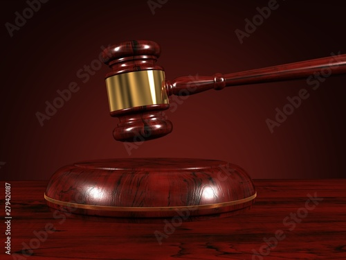 Valokuva  Wooden gavel isolated on brown background