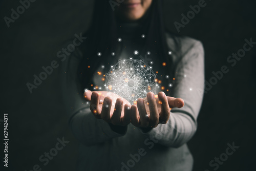 woman holding circle global network connection and data exchanges worldwide on work place background, business network communication and technology concept