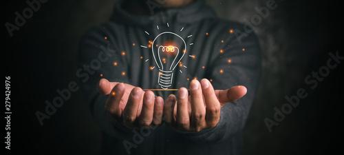Fotografía  man holding icon light bulb,idea concept,,Presenting new ideas.