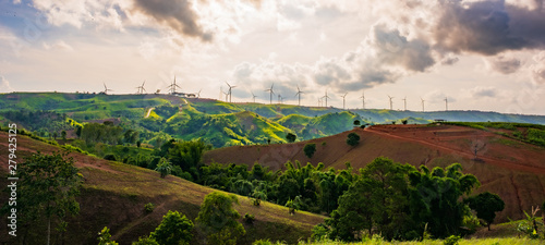 Obraz landscape image with Mountain and wind turbine panoramic view. - fototapety do salonu