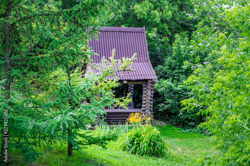 Photo Small log shed among green woods in Mazyr, Belarus