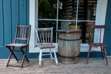 Barrel Table And Chairs Outside Store Window