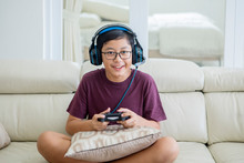 Preteen Boy Playing Video Games With A Joystick