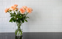 Peach Color Roses In A Glass Jug