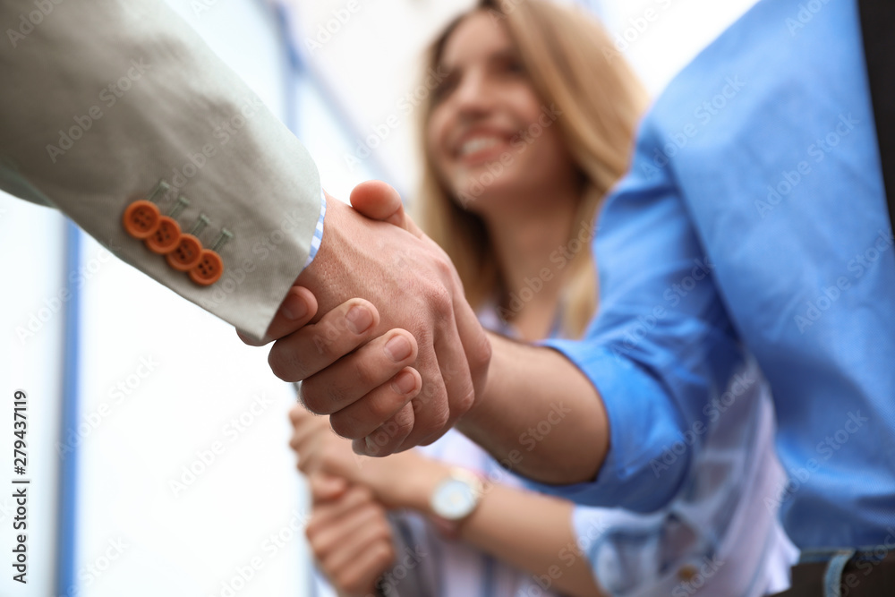 Fototapety, obrazy: Business partners shaking hands after meeting, closeup