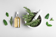 Flat Lay Composition With Herbal Essential Oil On Light Background