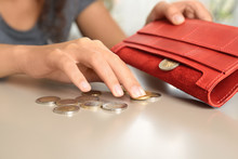 Young Woman With Coins And Wal...
