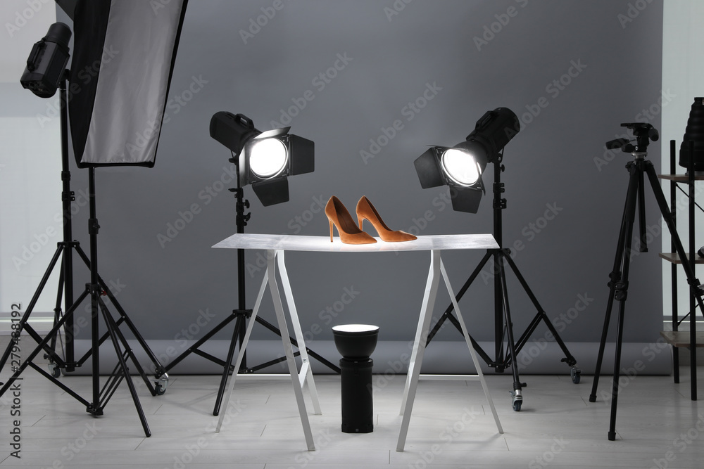 Fototapety, obrazy: Professional photography equipment prepared for shooting stylish shoes in studio