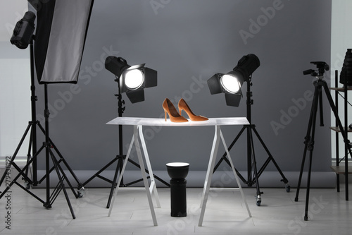 Fototapeta Professional photography equipment prepared for shooting stylish shoes in studio obraz