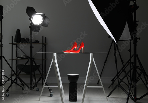 Obraz Professional photography equipment prepared for shooting stylish shoes in studio - fototapety do salonu
