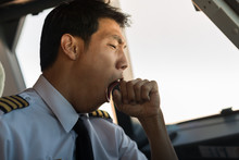 Tired Man Yawning At Work. Pilot Flying Airplane.