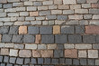 Texture of old colorful square paving stones