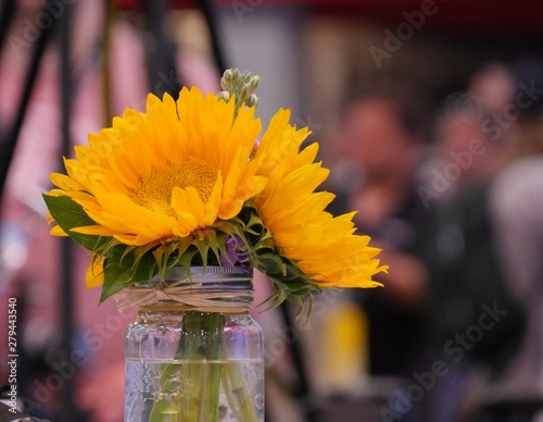 Yellow flowers in a glass vase, with soft background