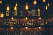 Leinwanddruck Bild - Vintage lamp with blurred liquor bar background