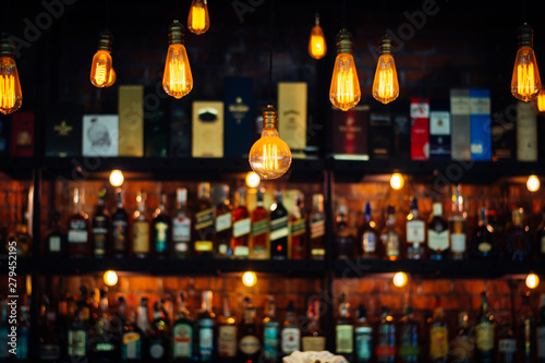 Vintage lamp with blurred liquor bar background Canvas Print