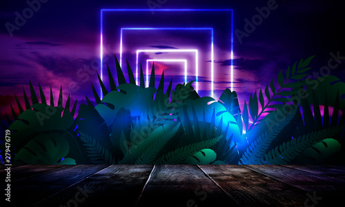 Dark empty room, wooden table, brick walls. Tropical leaves, neon light. Night view. - 279476719