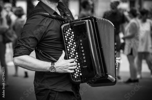 Fotografie, Tablou  closeup of hands of accordionist playing accordion in the street