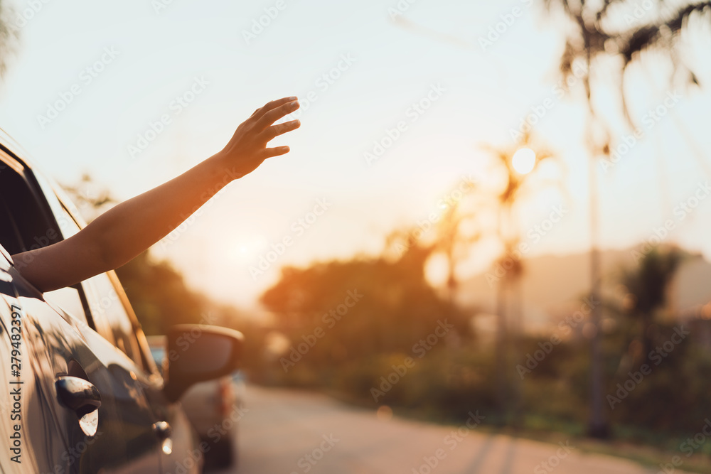 Fototapety, obrazy: Hatchback Car travel driving road trip of woman summer vacation in blue car at sunset,Girls happy traveling enjoy holidays and relaxation with friends together get the atmosphere and go to destination