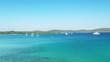 Croatia, Adriatic coast, peninsula on Veli Rat on the island of Dugi Otok, beautiful archipelago with sailboats and yachts, drone flying over blue lagoon