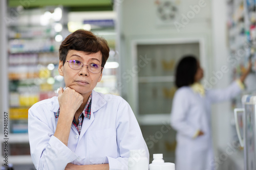 Fotografie, Obraz female elderly pharmacist she had problems with depression while working in phar