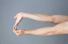 Stretching Exercises Finger On Grey Background, Health Care And Medical Concept