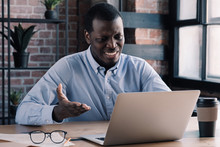 Angry Frustrated Tired Unhappy African American Office Worker Sitting At Table In Front Of Laptop Screen