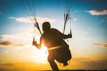 Paraglider Flying. Sunset. Take Off. Top View
