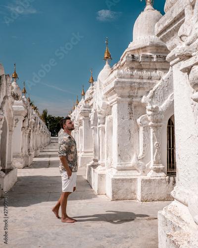 Kuthodaw pagoda the largest book in Mandalay, Burma Myanmar, happy