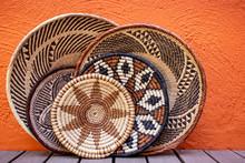 African Grass Baskets On An Orange Background
