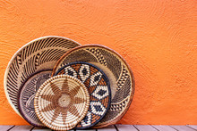 African Grass Baskets On An Orange Background