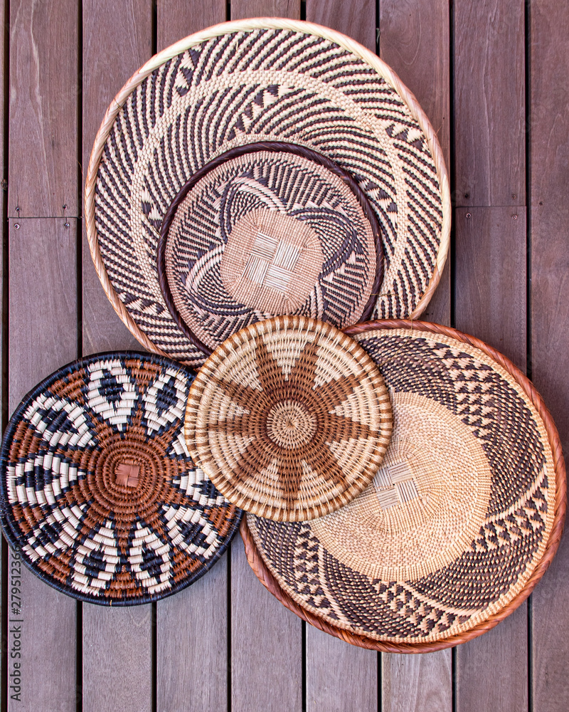Fototapety, obrazy: African grass baskets on a wooden background