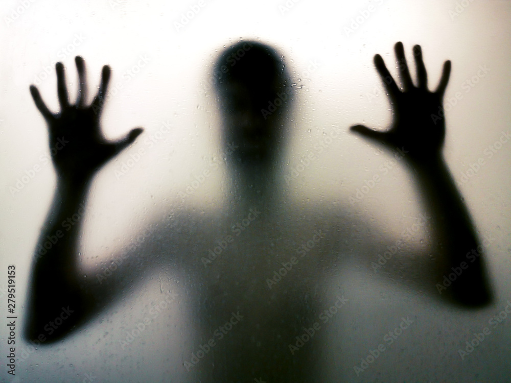 Fototapety, obrazy: Horror man behind the matte glass in black and white. Blurry hand and body figure abstraction. Halloween background. Murder concept. Criminal concpet.