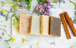 canvas print picture - Natural handmade soap bars with organic medicinal plants and flowers.Homemade beauty products with natural essential oils from plants and flowers, top view closeup photo