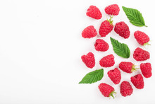 Raspberries With Leaves Isolated On White Background With Copy Space For Your Text. Top View. Flat Lay Pattern