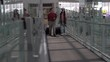 Happy asian senior couple walking together in airport waiting for departure at terminal . Elderly Journey. older lovers . travel. flight. retired . vacation