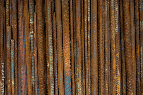 Valokuvatapetti Top view stack of straight old rusty high yield stress deformed reinforcement steel or iron bars