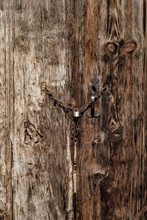 Old Wooden Gates With Small Metal Lock