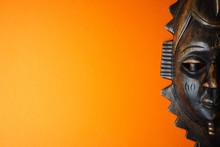 Wooden African Mask On Orange Background